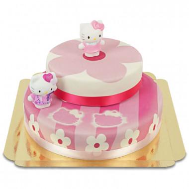 Hello Kitty figurer på en rosablommig tårta i två våningar